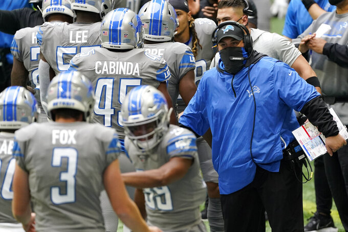 Detroit Lions head coach Matt Patricia greets players after a touchdown against the Atlanta Falcons during the first half of an NFL football game, Sunday, Oct. 25, 2020, in Atlanta. (AP Photo/John Bazemore)