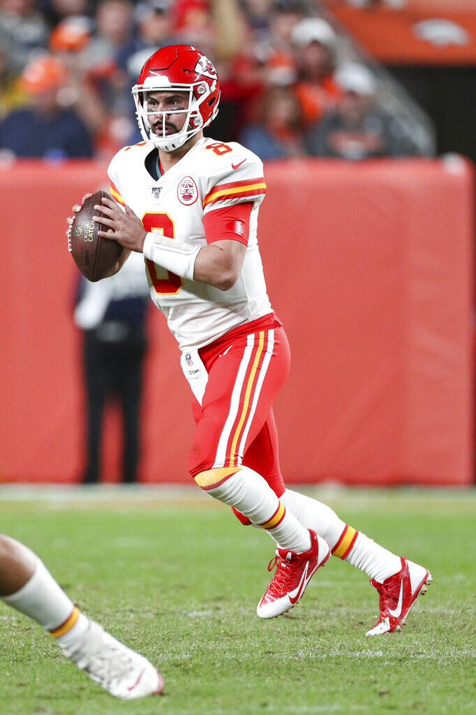 Kansas City Chiefs quarterback Matt Moore (8) looks downfield for a receiver in an NFL game against the Denver Broncos, Thursday, Oct. 17, 2019, in Denver. The Chiefs defeated the Broncos 30-6. (Margaret Bowles via AP)