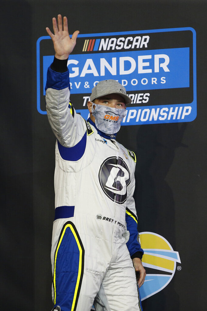 Brett Moffitt waves during driver introductions prior to the NASCAR Truck Series auto race at Phoenix Raceway, Friday, Nov. 6, 2020, in Avondale, Ariz. (AP Photo/Ralph Freso)