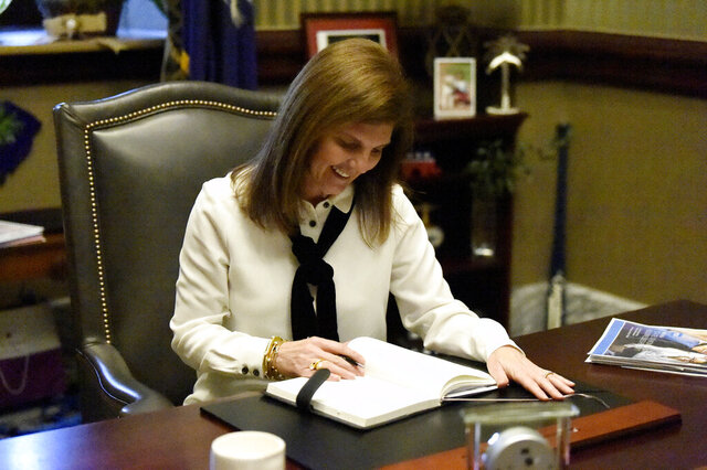 In this Tuesday, Dec. 10, 2019 photo South Carolina Lt. Gov. Pam Evette works in her office in the Statehouse  in Columbia, S.C. Evette, new to politics, is wrapping up her first year as South Carolina's second-in-command. (AP Photo/Meg Kinnard)