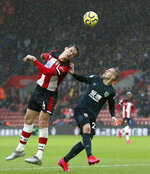 Southampton's Jannik Vestergaard (left) and Burnley's Matej Vydra battle for the ball, during the English Premier League soccer match between Southampton and Burnley at St Mary's Stadium, in Southampton, England, Saturday, Feb. 15, 2020. (Nigel French/PA via AP)