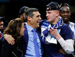 FILE - In this April 2, 2018, file photo, Villanova head coach Jay Wright celebrates with guard Donte DiVincenzo, right, after beating Michigan 79-62 in the championship game of the Final Four NCAA college basketball tournament, in San Antonio. (AP Photo/David J. Phillip, File)