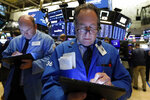 Trader Steven Kaplan, right, works on the floor of the New York Stock Exchange, Wednesday, June 19, 2019. Investors are in wait-and-see mode hours ahead of a widely anticipated Federal Reserve decision on interest rates. (AP Photo/Richard Drew)