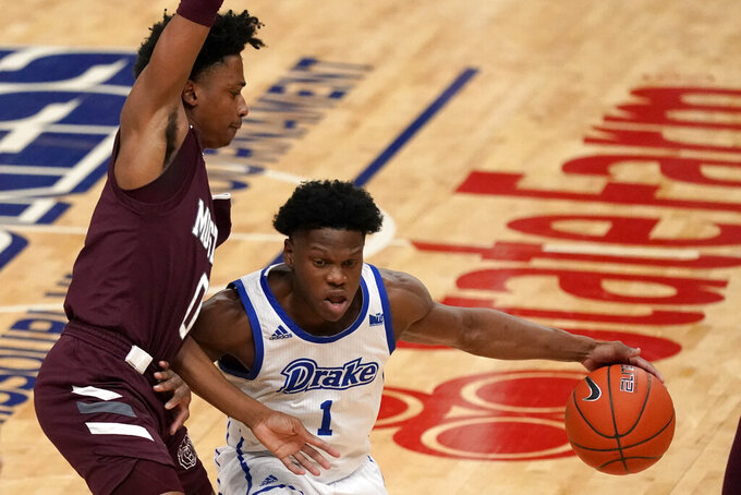 Drake's Joseph Yesufu (1) dribbles around Missouri State's Demarcus Sharp (0) during the first half of an NCAA college basketball game in the semifinal round of the Missouri Valley Conference men's tournament Saturday, March 6, 2021, in St. Louis. (AP Photo/Jeff Roberson)