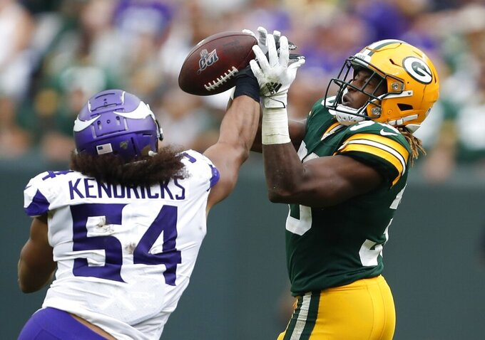 Minnesota Vikings' Eric Kendricks breaks up a pass intended for Green Bay Packers' Aaron Jones during the second half of an NFL football game Sunday, Sept. 15, 2019, in Green Bay, Wis. (AP Photo/Matt Ludtke)