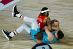 New Orleans Pelicans' Brandon Ingram (14) and Memphis Grizzlies' Grayson Allen (3) go for a loose ball during the second half of an NBA basketball game Monday, Aug. 3, 2020 in Lake Buena Vista, Fla. (AP Photo/Ashley Landis, Pool)
