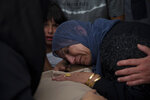 A Palestinian woman mourns over the body of Raed Jadallah, 39, who was killed by Israeli forces at the western entrance of his village while returning from work in the early hours of Wednesday morning, during his funeral, in the West Bank village of Beit Ur al-Tahta, Wednesday, Sep. 1, 2021. (AP Photo/Majdi Mohammed)