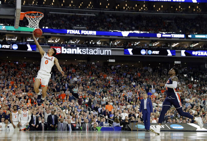 Virginia's Kihei Clark (0) goes up for a layup during the second half in the semifinals of the Final Four NCAA college basketball tournament against Auburn, Saturday, April 6, 2019, in Minneapolis. (AP Photo/David J. Phillip)