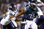 Philadelphia Eagles' Boston Scott (35) tries to rush past Seattle Seahawks' Bobby Wagner (54) during the second half of an NFL wild-card playoff football game, Sunday, Jan. 5, 2020, in Philadelphia. (AP Photo/Matt Rourke)