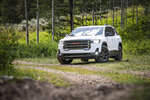 This photo provided by General Motors shows the GMC Acadia, a midsize SUV that has received significant updates for 2020, including new powertrains and a redesigned center console. (Darcy Bacha/Courtesy of General Motors via AP)