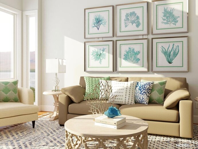 This undated photo rendering provided by Modsy shows a room decorated like an island getaway. Alessandra Wood, founder of online interior design platform Modsy, says you can invoke the vibe of your favorite island getaway through some well-chosen prints and materials.