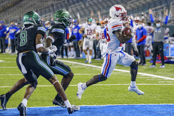 SMU running back Ulysses Bentley IV, right, scores a touchdown during the second half an NCAA college football game against Tulane in New Orleans, Friday, Oct. 16, 2020. (AP Photo/Matthew Hinton)