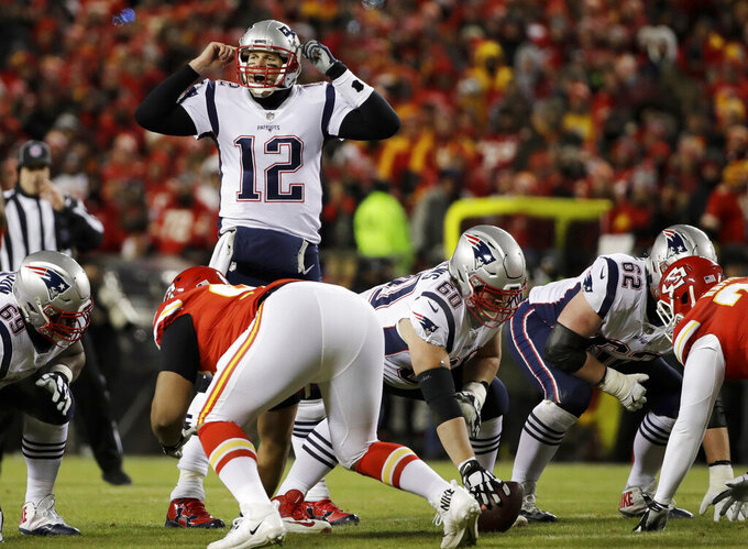 New England Patriots quarterback Tom Brady (12) calls a play during the first half of the AFC Championship NFL football game against the Kansas City Chiefs, Sunday, Jan. 20, 2019, in Kansas City, Mo. (AP Photo/Elise Amendola)