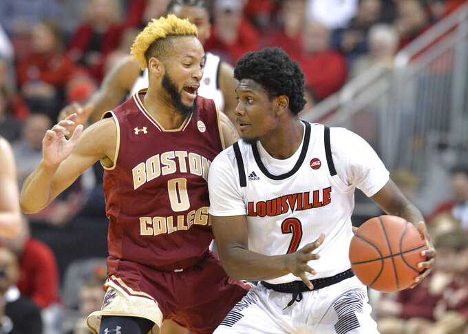 Louisville guard Darius Perry (2) looks for help from the defense of Boston College guard Ky Bowman (0) during the first half of an NCAA college basketball game in Louisville, Ky., Wednesday, Jan. 16, 2019. (AP Photo/Timothy D. Easley)