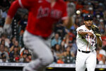 Houston Astros starting pitcher Luis Garcia, right, throws out Max Stassi during the third inning of a baseball game, Saturday, Sept. 11, 2021, in Houston. (AP Photo/Eric Christian Smith)