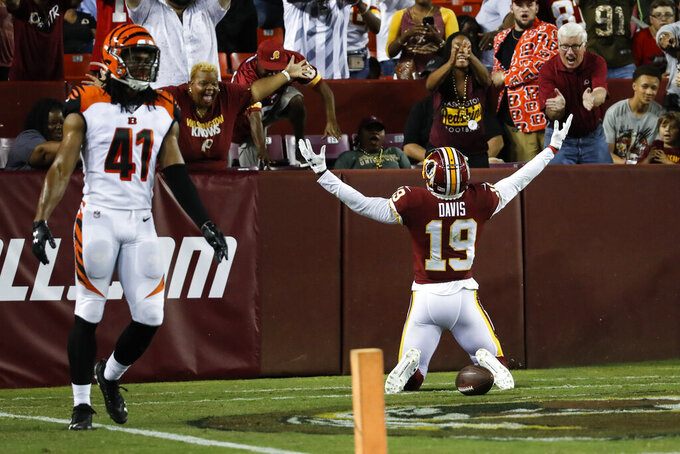 Washington Redskins wide receiver Robert Davis (19) celebrates his touchdown, next to Cincinnati Bengals defensive back Trayvon Henderson (41) during the first half of an NFL preseason football game Thursday, Aug. 15, 2019, in Landover, Md. (AP Photo/Alex Brandon)