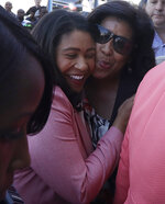 London Breed, left, hugs a supporter after speaking to reporters outside of City Hall in San Francisco, Wednesday, June 13, 2018. Breed was poised to become the first African-American woman to lead San Francisco following a hard-fought campaign when former state senator Mark Leno conceded and congratulated her Wednesday, more than a week after the election. (AP Photo/Jeff Chiu)