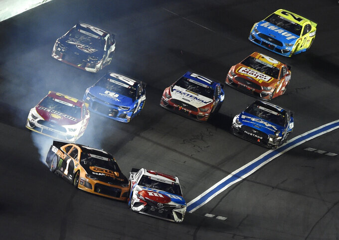 Kurt Busch (1) hits Kyle Busch (18) during the NASCAR Cup Series auto race at Charlotte Motor Speedway in Concord, N.C., Sunday, May 26, 2019. (AP Photo/Mike McCarn)
