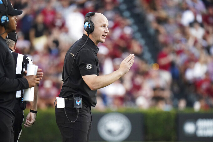 Vanderbilt head coach Clark Lea communicates from the sideline during the second half of an NCAA college football game against South Carolina, Saturday, Oct. 16, 2021, in Columbia, S.C. (AP Photo/Sean Rayford)