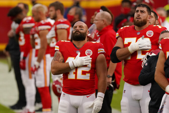 Kansas City Chiefs fullback Anthony Sherman (42) stands during the playing of the national anthem before an NFL football game against the New England Patriots, Monday, Oct. 5, 2020, in Kansas City. (AP Photo/Charlie Riedel)