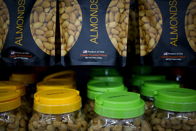 Imported nuts from the United States are displayed for sale at a hypermarket in Beijing, Wednesday, July 11, 2018. China's government has criticized the latest U.S. threat of a tariff hike as