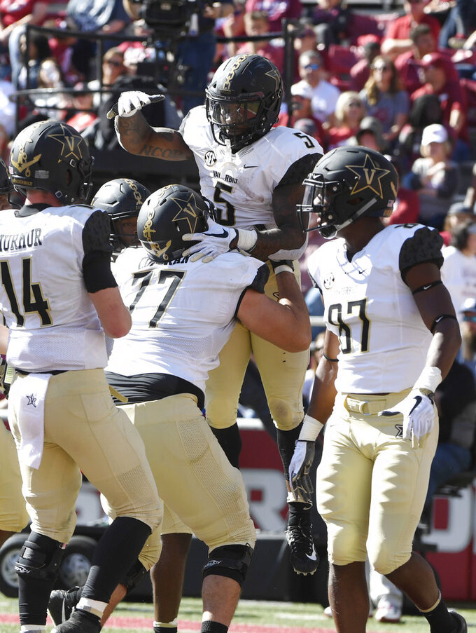 Vanderbilt running back Ke'Shawn Vaughn (5) celebrates with his team after scoring a touchdown in the second half of an NCAA college football game Saturday, Oct. 27, 2018, in Fayetteville, Ark. (AP Photo/Michael Woods)