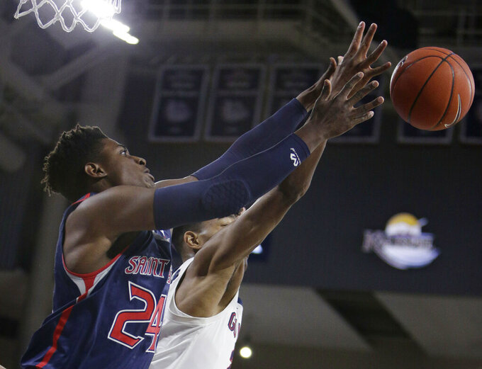 Saint Mary's forward Malik Fitts, left, and Gonzaga forward Rui Hachimura (21) go after a rebound during the first half of an NCAA college basketball game in Spokane, Wash., Saturday, Feb. 9, 2019. (AP Photo/Young Kwak)