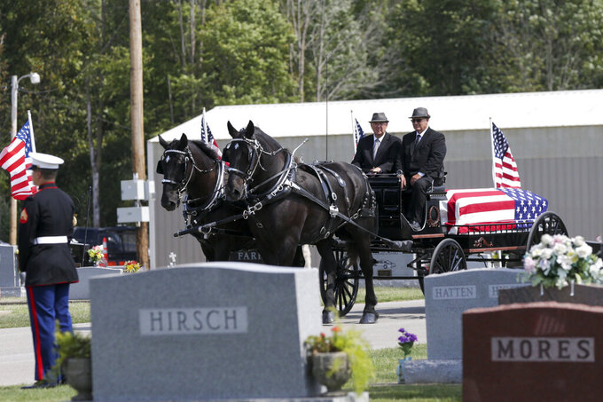 """A caisson carries Marine Cpl. Humberto """"Bert"""" Sanchez, Tuesday, Sept. 14, 2021, in Logansport, Ind. Sanchez was one of 13 U.S. service members to die in an explosion during evacuation efforts in Afghanistan. (Nikos Frazier/Journal & Courier via AP)"""