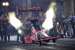 In this photo provided by the NHRA, Steve Torrence takes part in Top Fuel qualifying Friday, July 16, 2021, in the  Dodge/SRT Mile-High NHRA Nationals drag races at Bandimere Speedway in Morrison, Colo. (Jerry Foss/NHRA via AP)