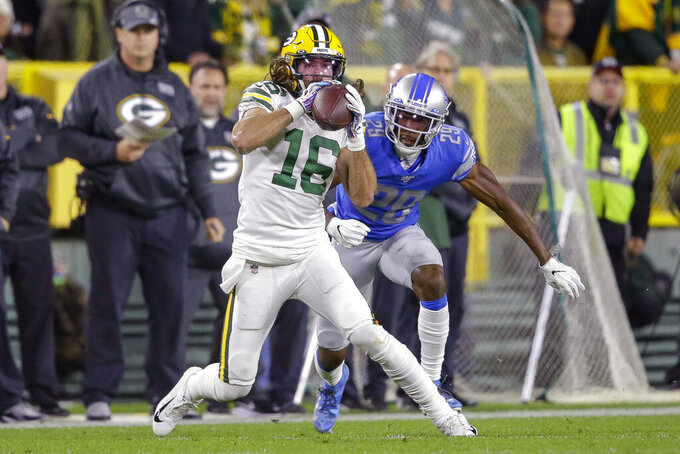 Green Bay Packers wide receiver Jake Kumerow (16) makes a catch while covered by Detroit Lions cornerback Rashaan Melvin during the first half of an NFL football game Monday, Oct. 14, 2019, in Green Bay, Wis. (AP Photo/Jeffrey Phelps)