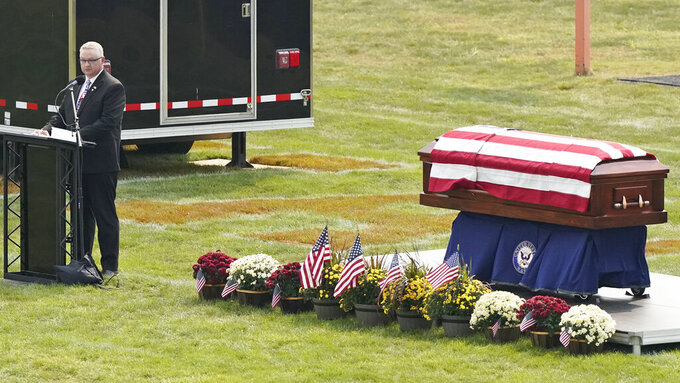 Kip Soviak speaks during the funeral of his son, Navy Corpsman Maxton Soviak, at Edison High School Stadium, Monday, Sept. 13, 2021, in Milan, Ohio. Maxton was one of 13 U.S. troops killed in a suicide bombing at Afghanistan's Kabul airport on Aug. 26. (AP Photo/Tony Dejak)