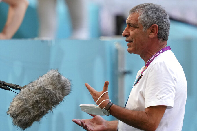 Portugal's manager Fernando Santos gestures during an interview prior to a team training session at the football arena stadium in Munich, Friday, June 18, 2021 the day before the Euro 2020 soccer championship group F match between Portugal and Germany. (AP Photo/Matthias Schrader)