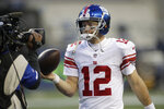 New York Giants quarterback Colt McCoy holds a game ball as he is interviewed after an NFL football game against the Seattle Seahawks, Sunday, Dec. 6, 2020, in Seattle. The Giants won 17-12. (AP Photo/Larry Maurer)