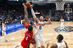 Phoenix Suns forward Frank Kaminsky (8) goes up for the ball next to New Orleans Pelicans forward Brandon Ingram and guard JJ Redick (4) during the first half of an NBA basketball game in New Orleans, Thursday, Dec. 5, 2019. (AP Photo/Gerald Herbert)