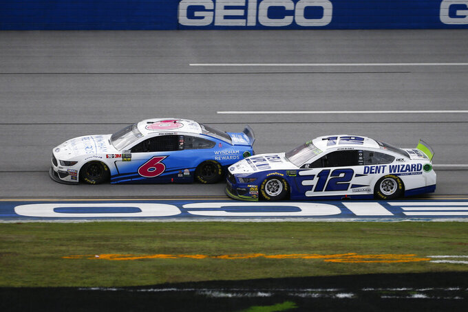 Ryan Newman (6) and Ryan Blaney (12) battle for the lead as they approach the finish line during a NASCAR Cup Series auto race at Talladega Superspeedway, Monday, Oct 14, 2019, in Talladega, Ala. (AP Photo/Butch Dill)