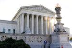 FILE - In this Nov. 10, 2020, file photo the sun rises behind the U.S. Supreme Court in Washington.  (AP Photo/Alex Brandon, File)