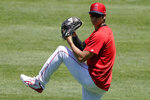 Los Angeles Angels' Shohei Ohtani pitches during baseball practice at Angels Stadium, Monday, July 6, 2020, in Anaheim, Calif. (AP Photo/Ashley Landis)