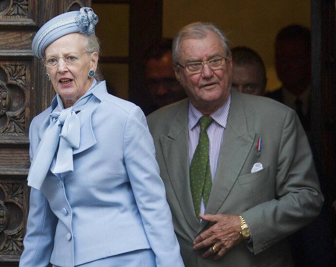 FILE - In this Oct. 21, 2014, file photo, Danish royals Queen Margrethe II, left, and Prince Henrik leave after visiting St. Mark church in Zagreb, Croatia. Prince Henrik, the French-born husband of Danish monarch Queen Margrethe who publicly vented his frustration at not being the social equal of his wife or their son in line to become Denmark's king, died late Tuesday, Feb. 13, 2018. He was 83. (AP Photo/Darko Bandic, File)