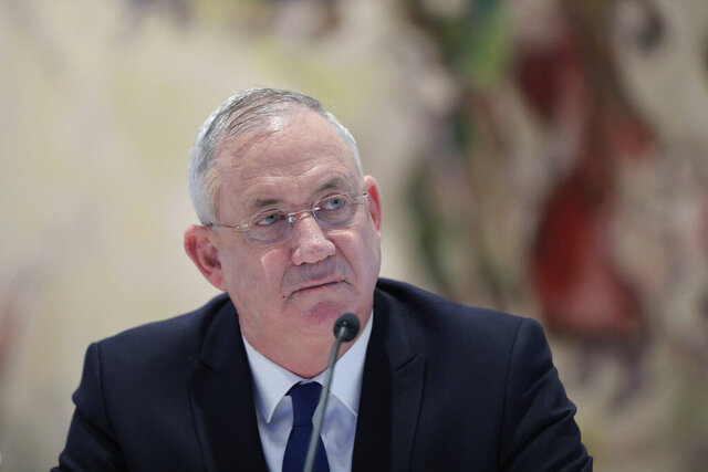 FILE - In this May 24, 2020 file photo, Israeli Defense Minister Benny Gantz attends the first Cabinet meeting of the new government at the Chagall Hall in the Knesset, the Israeli Parliament in Jerusalem, Israel. Gantz, Prime Minister Benjamin Netanyahu's chief governing partner on Tuesday, Dec. 1 said he would vote in favor of a proposal to dissolve their troubled coalition, accusing the Israeli leader of repeatedly breaking his promises and pushing Israel closer to its fourth election in two years. (Abir Sultan/Pool Photo via AP, File)