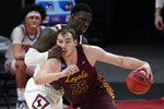 Loyola Chicago center Cameron Krutwig (25) drives on Illinois center Kofi Cockburn (21) during the first half of a men's college basketball game in the second round of the NCAA tournament at Bankers Life Fieldhouse in Indianapolis, Sunday, March 21, 2021. (AP Photo/Paul Sancya)
