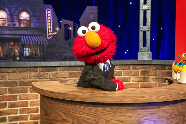 "This image released by Sesame Workshop shows muppet character Elmo, who will host a family friendly show called ""The Not Too Late Show with Elmo."" It begins streaming May 27 on HBO Max. (Richard Termine/Sesame Workshop via AP)"