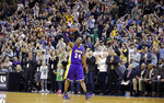 FILE - In this March 28, 2016, file photo, Los Angeles Lakers forward Kobe Bryant (24) waves as he walks off the court during the second half of an NBA basketball game in Salt Lake City. Bryant, the 18-time NBA All-Star who won five championships and became one of the greatest basketball players of his generation during a 20-year career with the Los Angeles Lakers, died in a helicopter crash Sunday, Jan. 26, 2020. (AP Photo/Rick Bowmer)