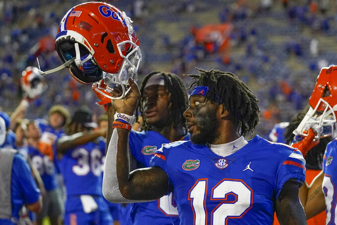 Florida wide receiver Rick Wells (12) celebrates with teammates after defeating Tennessee in an NCAA college football game, Saturday, Sept. 25, 2021, in Gainesville, Fla. (AP Photo/John Raoux)