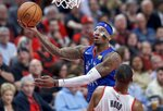 Denver Nuggets forward Torrey Craig shoots over Portland Trail Blazers guard Rodney Hood during the first half of Game 3 of an NBA basketball second-round playoff series Friday, May 3, 2019, in Portland, Ore. (AP Photo/Craig Mitchelldyer)