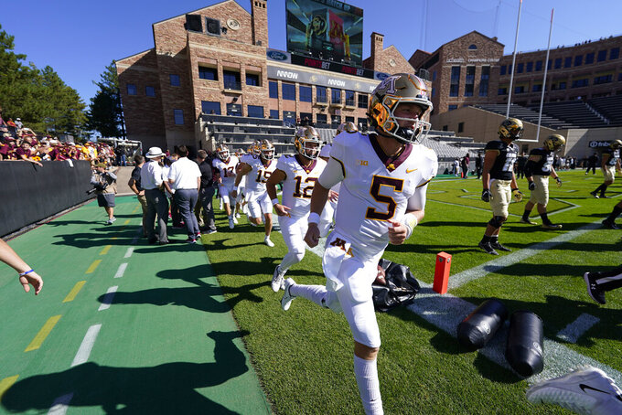 Minnesota quarterback Zack Annexstad heads out to warm up before an NCAA college football game against Colorado Saturday, Sept. 18, 2021, in Boulder, Colo. (AP Photo/David Zalubowski)
