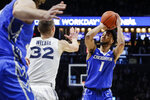 Creighton's Davion Mintz (1) shoots against Xavier's Ryan Welage (32) during the second half of an NCAA college basketball game Wednesday, Feb. 13, 2019, in Cincinnati. (AP Photo/John Minchillo)