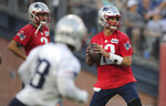 New England Patriots quarterback Tom Brady (12) looks to pass during an NFL football training camp practice in Foxborough, Mass., Monday, July 29, 2019. (AP Photo/Charles Krupa)