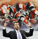 In this 2015 photo, Clemson head football coach Dabo Swinney speaks during the groundbreaking ceremony for a Football Facility Clemson Football Facility at Clemson University in Clemson, S.C. When it comes to facilities in the ACC, Clemson has set the standard.  The Tigers opened a $55 million team headquarters two years ago that includes a miniature golf course, a slide and a nap room. With the team pursuing its fourth straight ACC title and College Football Playoff berth, they feel the investment is paying off. (Ken Ruinard/The Independent-Mail via AP)