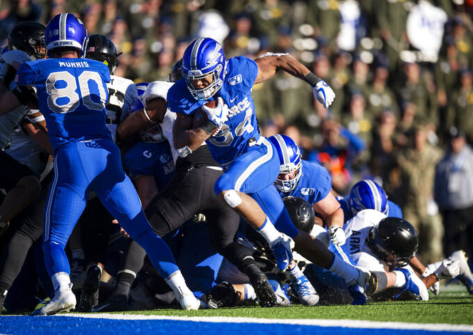 Air Force full back Timothy  Jackson (34) scores the first touchdown during the second half against Army during an NCAA college football game in Air Force Academy, Colo., Saturday, Nov. 2, 2019. (Chancey Bush/The Gazette via AP)