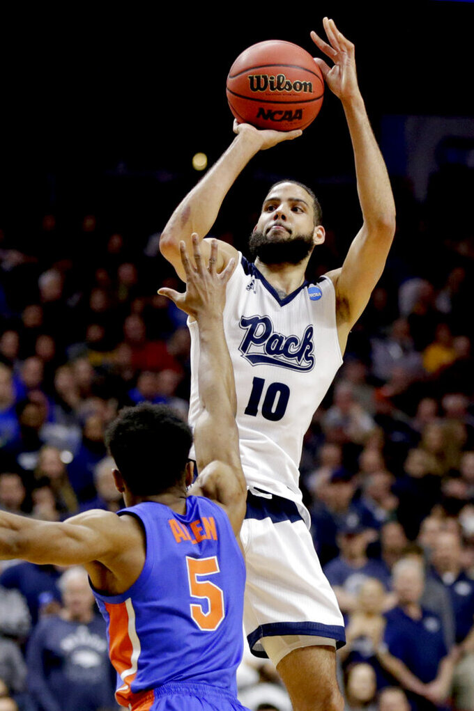 Nevada's Caleb Martin (10) shoots over Florida's KeVaughn Allen (5) during the first half of a first round men's college basketball game in the NCAA Tournament, in Des Moines, Iowa, Thursday, March 21, 2019. (AP Photo/Nati Harnik)